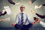 Mature business man is meditating to relieve stress of busy corporate life
