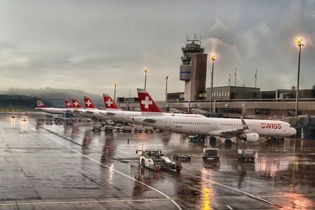 Some Swiss airplanes waiting for boarding on Zurich airport