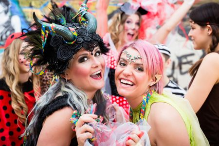 Women celebrating German Fasching Carnival in sexy costumes