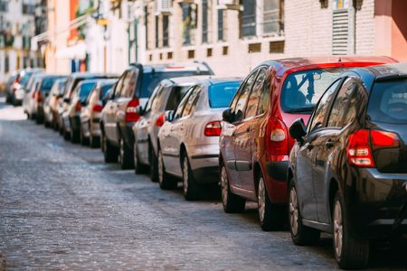 Cars Parked On Street In European City In Sunny Summer Day - 1