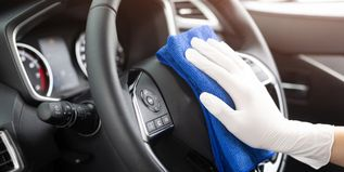 worker man wear gloves cleaning car interior console with microfiber cloth, detailing, car wash service concept. copy space. - 1