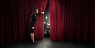 Woman open red curtains of the theater stage - 1