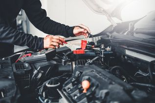 Technician Hands of car mechanic working in auto repair Service and Maintenance car battery - 1