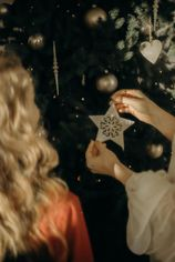 girls-putting-ornaments-on-a-christmas-tree-3154328